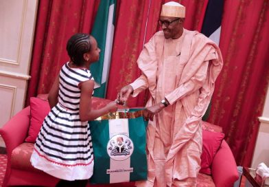 President Buhari meets 12-year-old who donated to his campaign, others